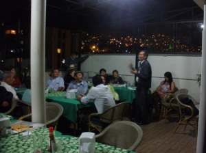 Miguel shares his writing with poets in Medellin
